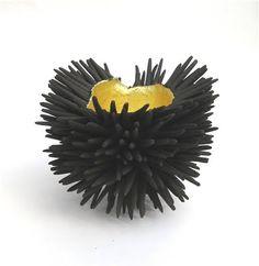 Black stoneware sculpture by British ceramic artist Claire Palastanga (b 1979). via Elemeno P