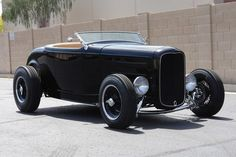 '32 Ford Highboy Roadster, matte black. Gorgeous.