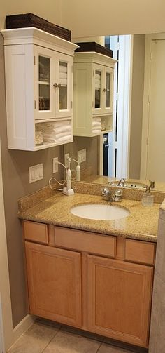 Good location for a cabinet in a small bathroom. Crown molding top of cabinet, back splash all the way around