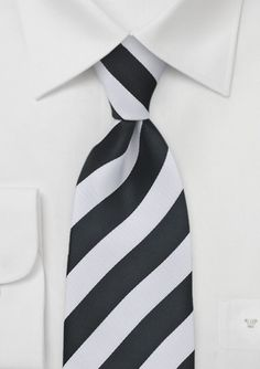 #bowsnties  This white and black silk tie would really make the best man stand out from the groomsmen!