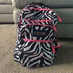 Zebra Print Jansport Backpack Zebra print Jansport backpack. I only used this for half of a school year! The only pocket that is kind of dirty is the small front pocket. Other than that, the back pack is in GREAT condition!! Really cute too!! ✨Please make an offer!✨ Jansport Bags Backpacks