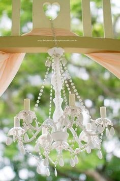 Brisbane Wedding Decorators signature wedding white chandelier creates a truly elegant wedding ceremony.  www.brisbaneweddingdecorators.com.au