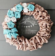 """Add a touch of charm to your home with this beautiful wreath!! Perfect for the front door, above the bed or on the wall. This scrunchy burlap wreath is made with natural colored burlap. The color of the roses and bow is up to you! My current colors include: turquoise orange red white black steel grey yellow lavender mint hunter green celery green brown slate blue royal blue coral At check out, please indicate which TWO color roses you would like in the """"Leave a Note"""" section. Custom colors…"""