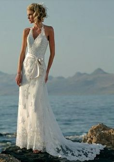 I LOVE this dress!! i love the lace train, and how it looks like foam over the rocks in this pic, but the dress as a whole is beautiful!! and great for a second, or more mature bride. Halter Net Floor-length A-line Wedding Dress - Gardeniasite