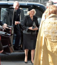 Prince Charles and the Duchess of Cornwall were last to arrive at the memorial service for Sir David Frost, which started at noon on Thursday, 13 March 2014.
