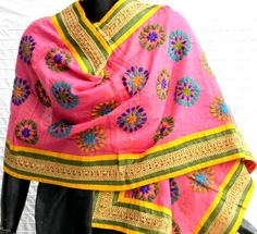 This stunning pink chanderi dupatta/stole is embroidered with wool using traditional phulkari embroidery in a floral pattern, and has a broad gold lace bord