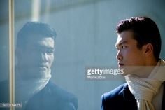 Stock Photo : Young man looking the window