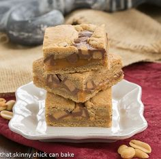 Chocolate Peanut Butter Caramel Bars | Peanut butter cookie dough, a layer of caramel, peanut butter cups and more dough!!!