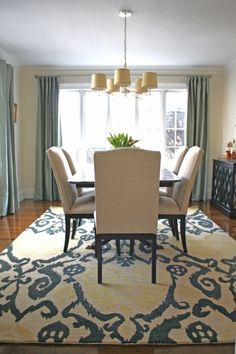 "Tips for dining room rug size: #1 – Take the measurements of your table and add 54-60″ to the width and length. This will give you an extra 27-30″ on all sides so that your chairs always stay on the rug even when they are pulled away from the table. #2 – Leave at least 18"" of floor showing around the perimeter of the room. This will make your space feel bigger and show off your rug better."