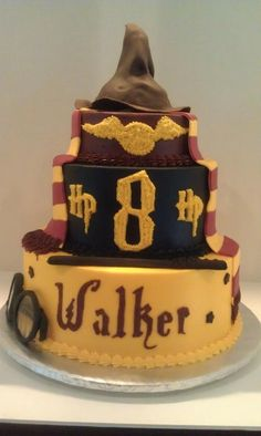 Harry Potter cake in buttercream with fondant trim, fondant scarf, wand, and hat. glasses are made of fondant and dugar glass candy.