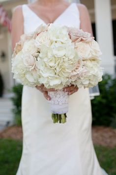 The bridal bouquet will be a small clutch bouquet of white hydrangeas, ivory garden roses, white spray roses and blush pink garden roses wrapped in ivory ribbon with the stems showing.