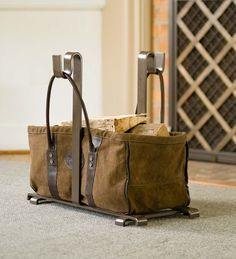Their Heavy Duty Canvas Log Carrier is handsome and hard working. It easily stands up to the log-hauling chore and looks good by your fireplace holding wood or kindling. This firewood carrier is handmad Firewood Carrier, Log Carrier, Stove Accessories, Firewood Logs, Wood Rack, Fireplace Hearth, Fireplaces, Fireplace Ideas, Welding Projects