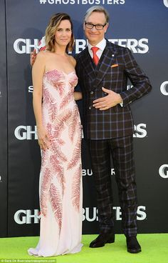The big night: Wiig looked stunning as she posed next to director Paul Feig