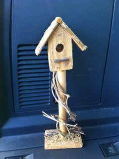 "$.10 Decorative 12"" tall birdhouse. Found at a church sale."