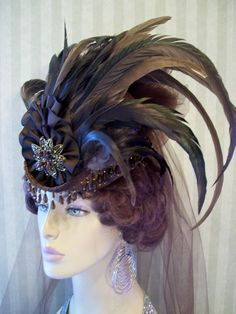 Mini Riding Hat Steampunk Hat Mini Top Hat Victorian Hat Victorian Hat - Coque Feathers. $59.99, via Etsy.