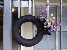 Black Halloween Wreath with Black Feathers and  Orange & Purple Glitter Balls. $35.00, via Etsy.