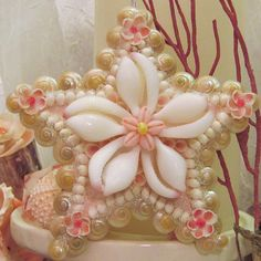 Pearly pink and white seashell star ornament. Reminiscent of seashell valentines, this intricate seashell art complements any coastal, nautical,