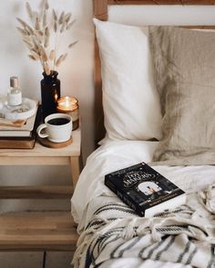 The kind of bed you would like to retire to for an early night with a good book…. The kind of bed you would like to retire to for an early night with a good book. Beautiful light bright interiors, linen bedding and candles make this a cosy hygge bedroom