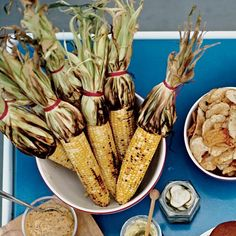 Grilled Corn with Mango-Habanero Butter | Bobby Flay likes to cook corn on the cob with the husk tied back into a kind of handle. He soaks the bundle in cold water before it goes on the grill for two reasons: It steams the kernels a little, making them tender, and it prevents the husks from burning.