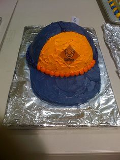 Cub Scout Cap Cake by bickelt, via Flickr this is a great idea for blue and gold banquet