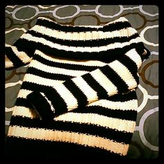 Guess Sweater Gorgeous, classy off the shoulder sweater. Black and white (off white ) stripes. Very warm and lovely. Used a few times. Zero stains Guess Sweaters Cowl & Turtlenecks