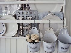 white enamel buckets, old stencils, and white ironstone