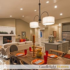 Colorful open concept kitchen, dining, and living room. Perfect for entertaining!  www.candlelighthomes.com