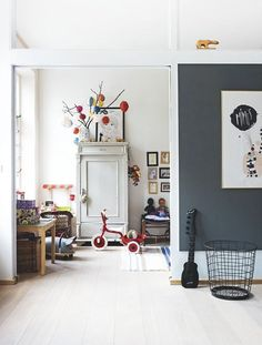 this is a beautiful danish home in a former post office with a lot of open space im in love with the light ash wooden floor and how the owners combined amazing playroom office shared space
