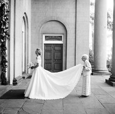 We love a feisty Grandma! Bride Lenore's Grandmother insisted on this wedding day photo of her holding the train of her only Grandaughter's gown. Lenore wore a custom Anne Barge wedding dress with a scalloped lace hem and lace off the shoulder bolero. This photo is a keepsake to pass down the generations! Photo by Virgil Bunao.