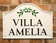 White sign with Olives motif with black letters. Sent to portugal. www.rockartisansigns.co.uk