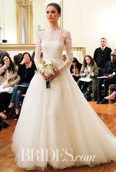 """Brides: Peter Langner - Spring 2017. """"Belle"""" sheath gown with long sleeves, in silk organza, tulle and beaded bodice by Peter Langner"""