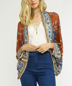 Add a layer of lovely boho-chic style with this relaxed cardigan featuring a draped silhouette and colorful pattern-play.