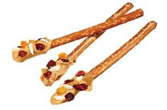 Spread Peanut Butter on top of pretzel rods.  Roll in chopped nuts or dried fruit... Great grab-n-go idea!