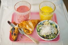 Croissant w blueberry jam, fruit salad w sunflower seeds and desiccated coconut, raspberry/banana smoothie, orange juice