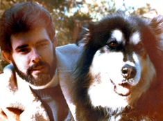 George Lucas and his Alaskan Malamute Indiana.  Indiana was the inspiration for Chewbacca in Star Wars.  She sat with him all the time as he was writing the script.