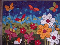 mosaiquismo. Lovely mosaic garden with flowers and butterflies