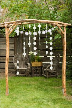 Paper doilies (or snowflakes!) glued to lengths of ribbon - photo backdrop or decoration behind headtable