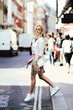 Browse the best summer street style outfit ideas at @stylecaster | 'Framboise Fashion' blogger in white blazer and sneakers, colorful striped skirt