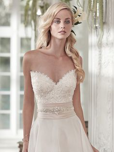 Maggie Sottero - POPPY, Romantic lace and a soft Vicenza organza combine to create this timeless A-line wedding dress, with sweetheart neckline and wide Soft Shimmer satin belt, glittering with Swarovski crystals, at the waist. Finished with half corset and half zipper closure.