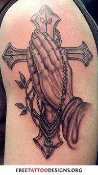 praying hands and cross