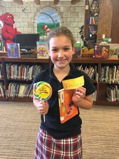 She found the golden ticket! This school library hides tickets in seldom-read books. The finder can redeem for a prize, like her giant lollipop! Submitted by: The Covenant School
