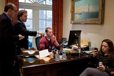 Axelrod, speechwriter Cody Keenan, and Favreau working on the president's statement concerning the shooting of Representative Gabrielle Giffords and others in Tucson, Arizona.
