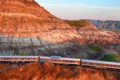 Canada: From sea to sea, by train - Matador Network   Badlands, Alberta  At the last moment of a prairie sunset, The Canadian rolls across the otherworldly landscape near Drumheller, Alberta. While the dinosaurs that walked here are now fossils, there are still Jurassic mosquitoes to contend with.
