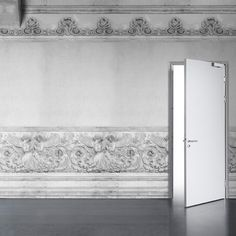 Transform your bare office into an Italian palazzo with this wallpaper by UK designers Young & Battaglia that lets you pretend to be surrounded by Renaissance-style angels carved in stone.