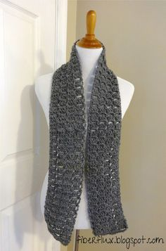This scarf was designed with everybody in mind...it has just enough texture to hold its own with solid yarn, but isn't too busy to hand...