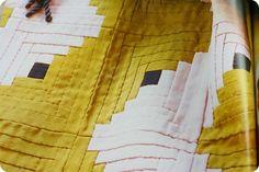 three color log cabin quilt.