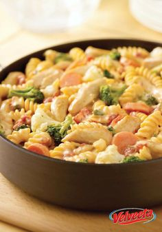 VELVEETA Cheesy Chicken Rotini - What makes this dish so rich and creamy? The way the cheese melts in and through all the pasta, veggies and slightly hot chiles. All this and it's smart eating, too.