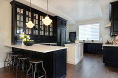 Jillian Harris - kitchens - white and black kitchen, glass front kitchen cabinets, white kitchen island, black perimeter cabinets, black cab...