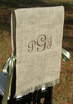 Burlap chair covers for a rustic wedding.  One for the bride and one for the groom - how chic is that!