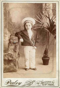 "ca. 1898, [cabinet card, portrait of a young girl dressed in a sailor's uniform with ""USS Maine"" printed on the hat band], Paley"